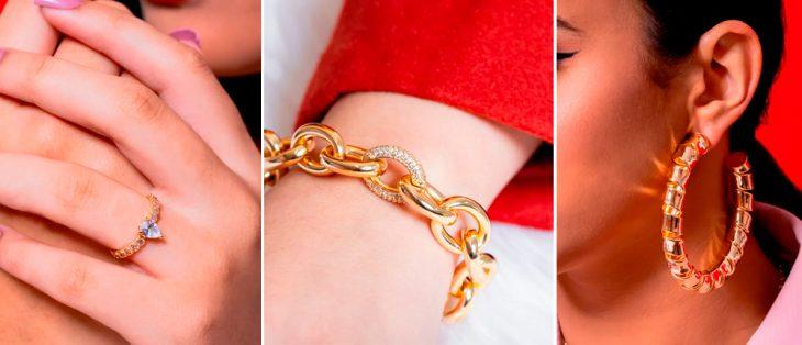 mão com um anel dourado, braço com colar dourado, mulher com brinco dourado de argola