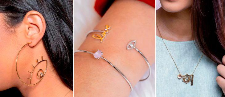 mulher com brinco de argola com olho que tudo vê, braço com colar prata e um bracelete escrito love, mulher com colar longo