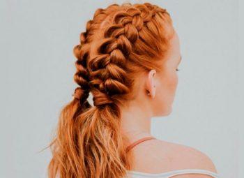 mulher ruiva de costas exibindo tranças dos dois lados da parte de trás da cabeça